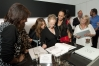 Iran signing books as Nadine Borgomanero and Barbara Becker look on