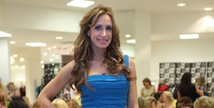 Lili Estefan in Aidan Mattox dress, YSL shoes at Nora Bulnes birthday at Saks Fifth Avenue